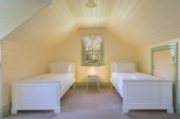 The loft features 4 single beds