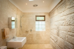 Bathroom with sandstone feature wall