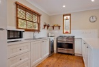 fully equipped gourmet kitchen with large oven
