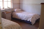 second bedroom downstairs with two single beds